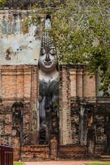 Tourist is traveling at Sukhothai Historical Park (Wat Sri Chum) in Thailand.