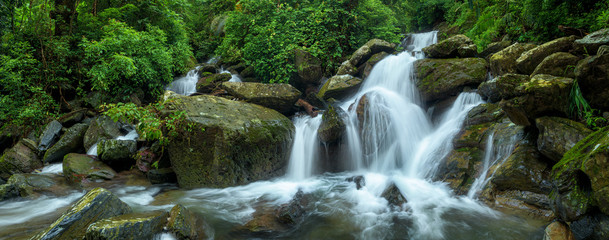 Panoramic beautiful deep forest waterfall in Thailand Fototapete
