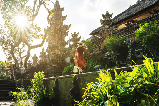 Travel in Bali, Image of woman tourist walking in Pura saraswati temple in Indonesia.