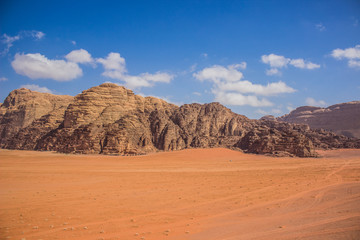 picturesque desert scenery landscape background photography with big sand valley foreground and huge mountain ridge background