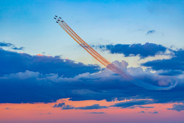 Airplanes at a airshow demonstration
