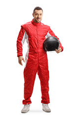 Racer in a red uniform holding a helmet and smiling
