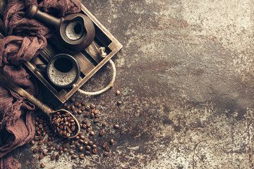 Wall Mural - Coffee on wooden tray with coffee beans on dark textured background. Top view with copy space. Background with free text space.