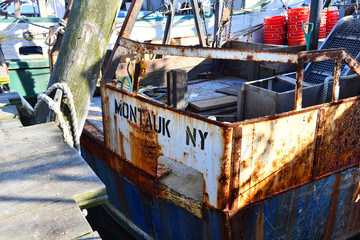 Weathered stenciling on commercial fishing boat at Montauk, New York