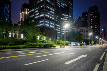 Office buildings and highways at night in the financial center, qingdao, China Fotomurales