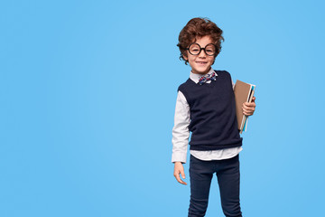 Smiling adorable wunderkind with notebooks
