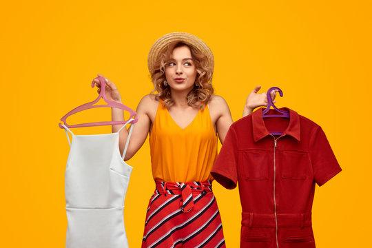 Stylish female choosing outfit