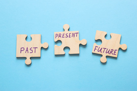 Words Past, Present and Future written on wooden puzzles, time concept.