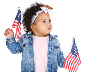 Beautiful baby girl with american flags on white background