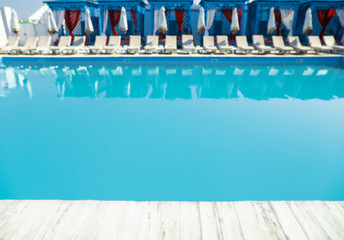 Blurred view of clean swimming pool on sunny day
