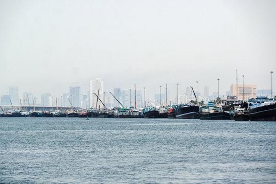Boats and skyline at the Coast in Dubai