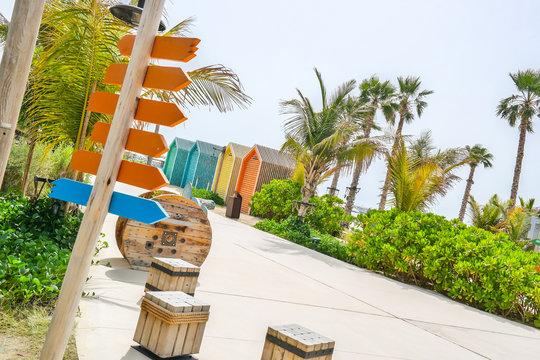 Beach in Dubai with signs - dubai