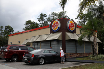 A Burger King restaurant boarded up with storm shutters is seen ahead of the arrival of Hurricane Dorian in Flagler Beach