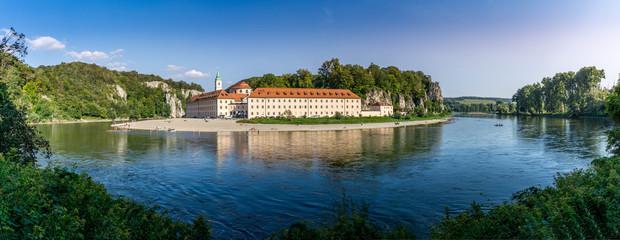 Fototapeta Panorama view on Weltenburg Abbey - Kloster Weltenburg. This landmark is a Benedictine monastery in Weltenburg in Kelheim on the Danube in Bavaria, Germany.