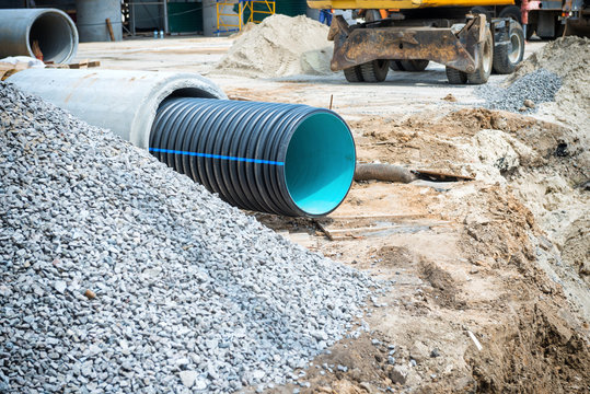 Big pipe or tube for water sewer on construction site during road repair