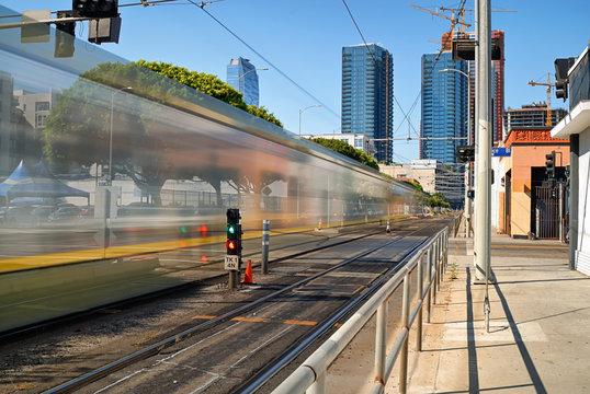 The light rail metro train speeding doen Flower St. in Los Angeles.