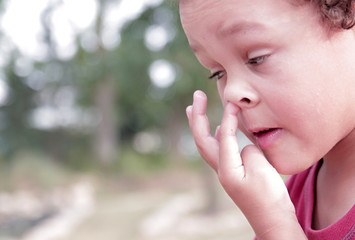 little boy picking his nose stock image stock photo