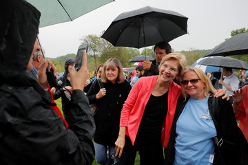 Democratic 2020 U.S. presidential candidate Warren poses for a photograph with a voter at a campaign house party in Hampton Falls
