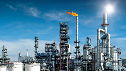 Close-up view Oil and gas industrial refinery zone,Detail of equipment oil pipeline steel with valve from large oil storage tank at cloudy sky. -image Wall mural