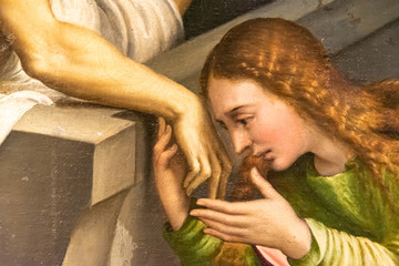 Detail of medieval painting showing Mary Magdalene kissing Jesus´s hand