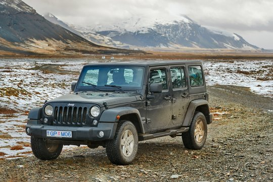 HOFFEL, ICELAND - MAY 03, 2018: Jeep Wrangler Unlimited four wheel drive vehicle on Icelandic landscape, snow in background