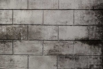 Grey brick wall, brickwork background of dark stone textured for design. Old vintage concrete block...