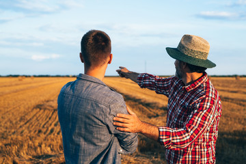two ranchers talking outdoors on field Wall mural