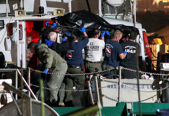 Rescue personnel return to shore with the victims of a pre-dawn fire that sank a commercial diving boat off the coast of  Santa Barbara, California