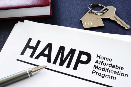 Stack of Home Affordable Modification Program HAMP documents.