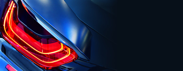 Car detail. New led taillight in hybrid sports car. copy space