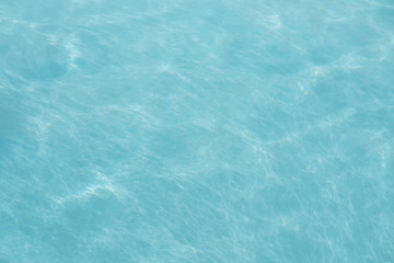 Surface of swimming pool water background.