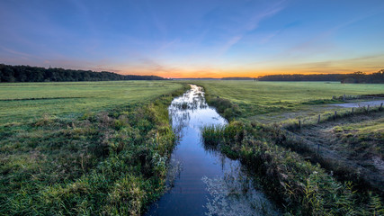 Wall Mural - Sunset Landscape of lowland river