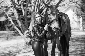 Hobby concept, woman with a horse on a horse farm. Human and animals friendship
