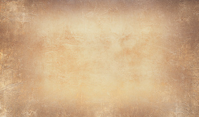 Grunge texture of old vintage paper. Beautiful textured background in brown tones.