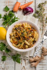 fusilli with onion carrot parsley and lemon grated peel