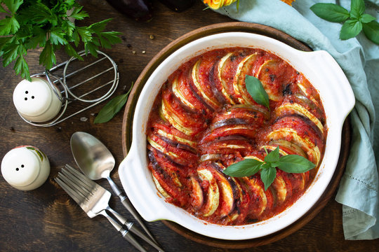 Healthy and diet food concept. Ratatouille, vegetarian meal on a rustic wooden table. Top view flat lay.