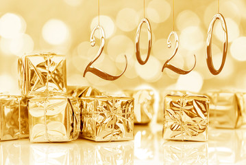 2020, new year card, small Christmas gifts in shiny golden paper, bokeh lights background, season...