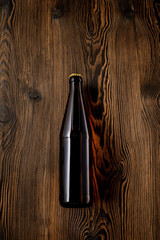 beer bottle on wooden table . Top view