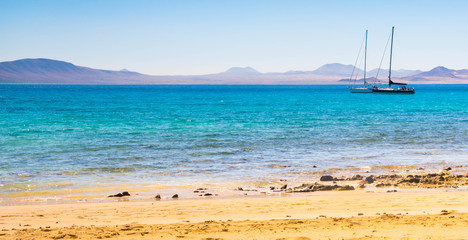 paradise beach at La Graciosa Island with view on Lanzarote, Canary Islands, Spain