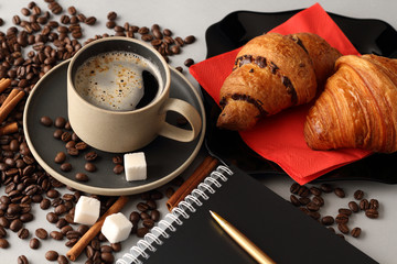 Papiers peints Café en grains Morning coffee, croissants and a notebook with a pen