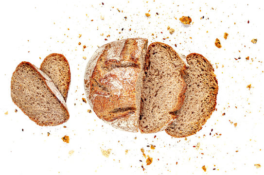 Sliced Multigrain bread isolated on a white background. Rye Bread  slices with crumbs. Top view. Close up