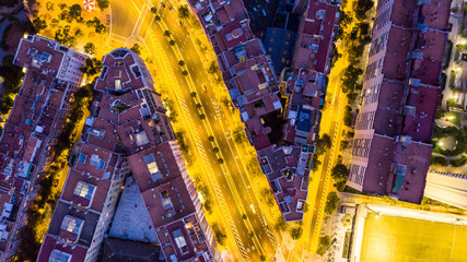 Night city traffic. Beautiful details of architecture. Barcelona Spain. Yellow and purple. Drone art creative photo