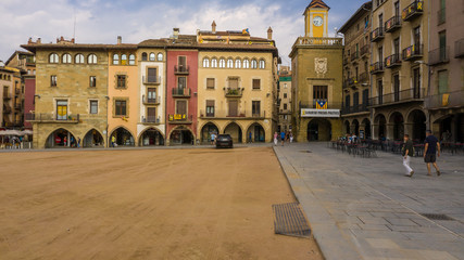 Vic Catalonia Spain Placa Major Main Square . Golden light. Summer time. People walking streets