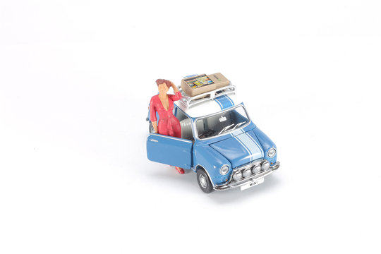 fun of miniature people figure travel with car