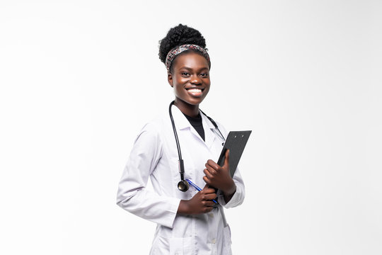 Portrait of happy african medical intern doctor writing on clipboard isolated on white background