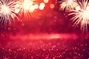 Fototapete - Abstract background holiday, Red and gold Fireworks and bokeh in New Year eve and copy space.