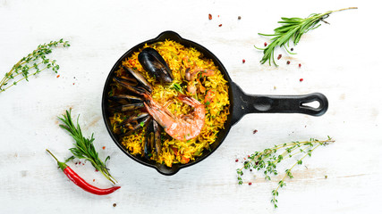 Seafood rice. Paella with mussels and shrimp. Top view. Free space for your text.