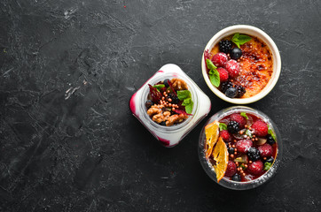 Dessert with fruits, berries and nuts. Top view. Free space for your text.