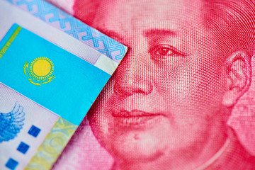 Chinese money Yuan and Kazakh tenge. Currency exchange concept, rise and fall in the business market