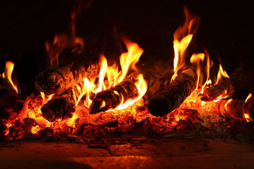 Burning wood in a fire place